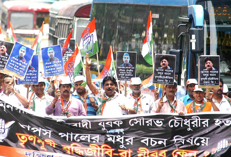 Youth Congress workers participate in a rally organised to protest against Mamata Banerjee-led West Bengal government in Kolkata on July 13, 2014. - Mamata Banerjee