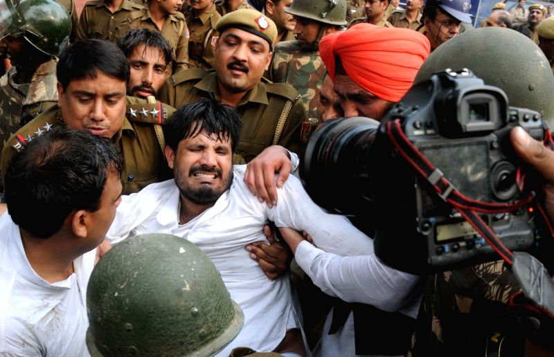 Youth Congress workers were detained while heading towards the Parliament House to protest over the issue of intolerance in New Delhi on Nov 30, 2015.