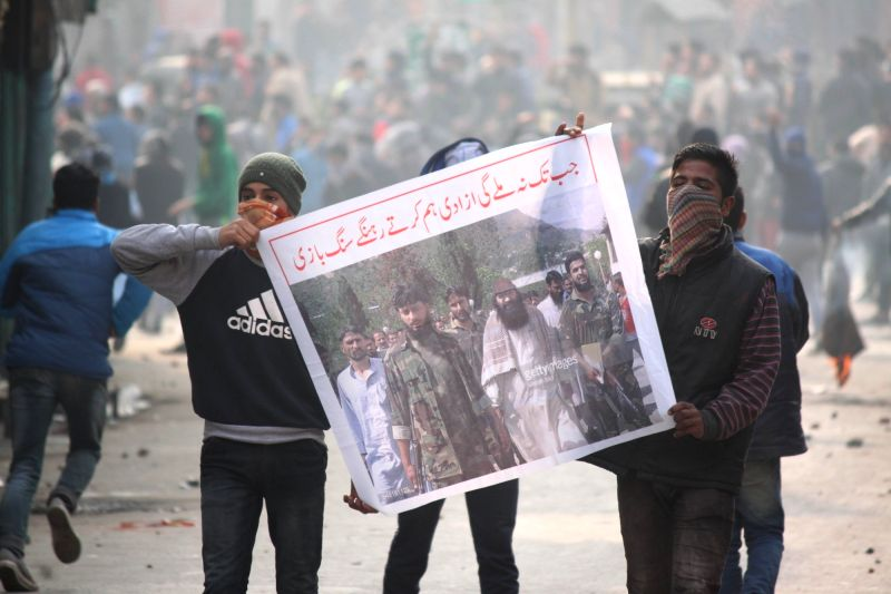 Youths stage a demonstration in Srinagar, on Nov 20, 2015.