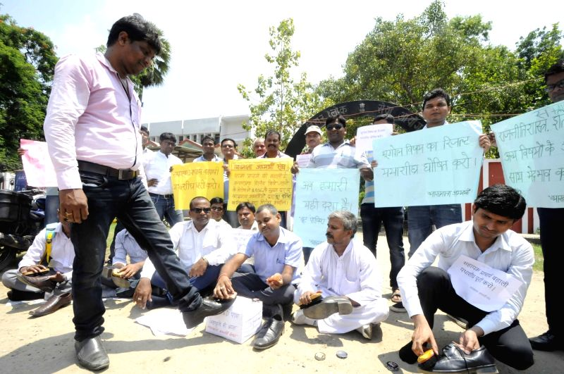 Youths stage a demonstration to press for their demands outside Bihar Public Service Commission (BPSC) in Patna, on July 17, 2017.