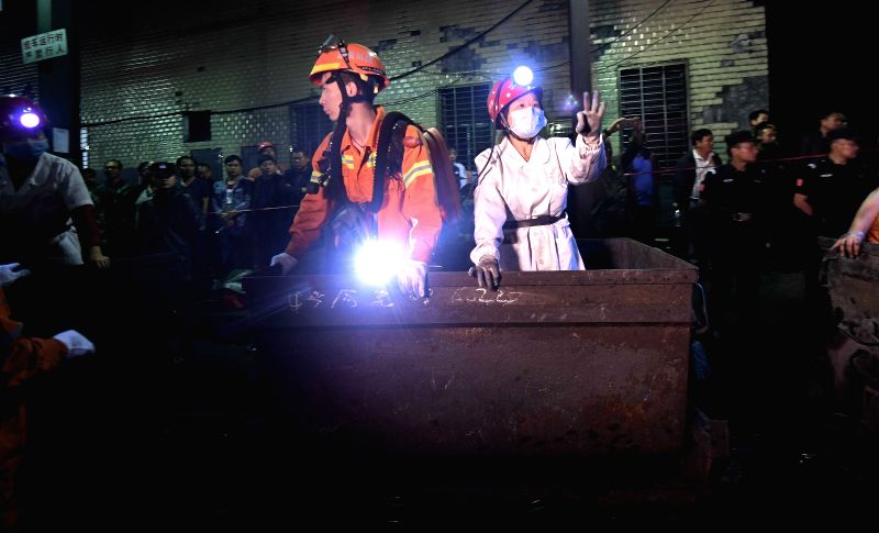YOUXIAN, May 8, 2017 - A medical worker gestures to show three trapped miners being rescued at the Jilinqiao colliery in Huangfengqiao Township, Youxian County, central China's Hunan Province, May 8, ...