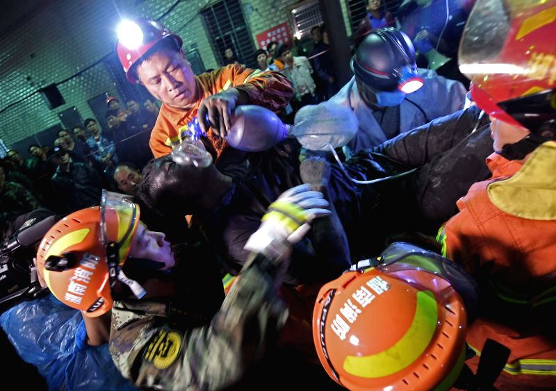 YOUXIAN, May 8, 2017 - A trapped worker is rescued from the Jilinqiao coal mine in Huangfengqiao Town of Youxian County, central China's Hunan Province, May 8, 2017. A gas leaking occurred Sunday ...