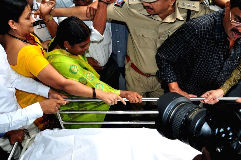 YSR Congress honorary president Y.S. Vijayalakshmi by the body of late YSR Congress leader Shobha Nagireddy who succumbed to the injuries sustained in a road accident en route to her native place ...