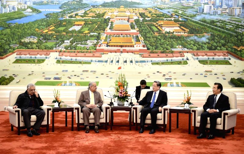 Yu Zhengsheng (2nd R), chairman of the National Committee of the Chinese People's Political Consultative Conference, meets with Chairman of the Pakistani Senate ...