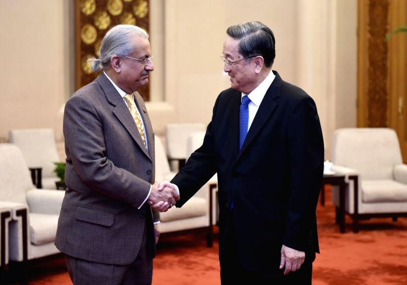 Yu Zhengsheng (R), chairman of the National Committee of the Chinese People's Political Consultative Conference, meets with Chairman of the Pakistani Senate Mian ...