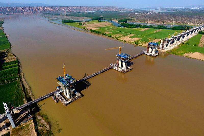 YUNCHENG, April 30, 2017 - Photo taken on April 29, 2017 shows the construction site of a bridge across the Yellow River as a section of Yuncheng-Lingbao Expressway in Yuncheng City, north China's ...