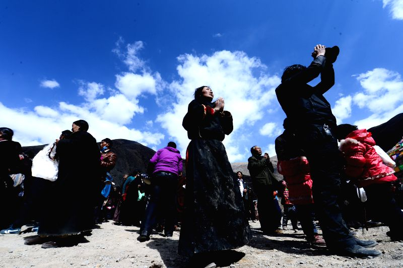 Citizens of the Tibetan ethnic group pray for Yushu Earthquake victims during a Ghyo-Ku ceremony at the Dangka Monastery in Yushu, northwest China's Qinghai ...