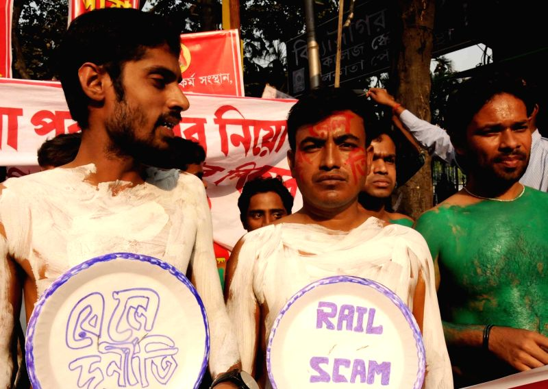 Yuva League activists stage a demonstration protest against the corruption in railway recruitment in Kolkata, on Nov 24, 2015.