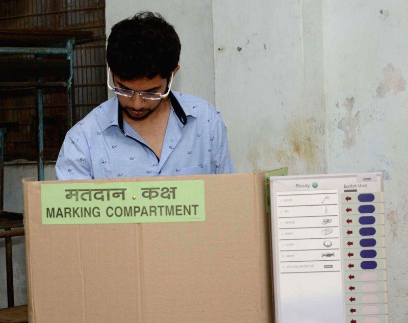 Yuva Sena president Aditya Thackeray  casts his vote at a polling booth during the sixth phase of 2014 Lok Sabha Polls in Mumbai on April 24, 2014.
