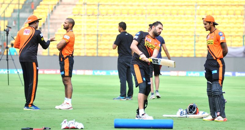 Yuvraj Singh of Sunrisers Hyderabad during a practice session at Chinnaswamy Stadium in Bengaluru on April 24, 2017. Also seen Shikhar Dhawan and VVS Laxman. - Shikhar Dhawan and Yuvraj Singh