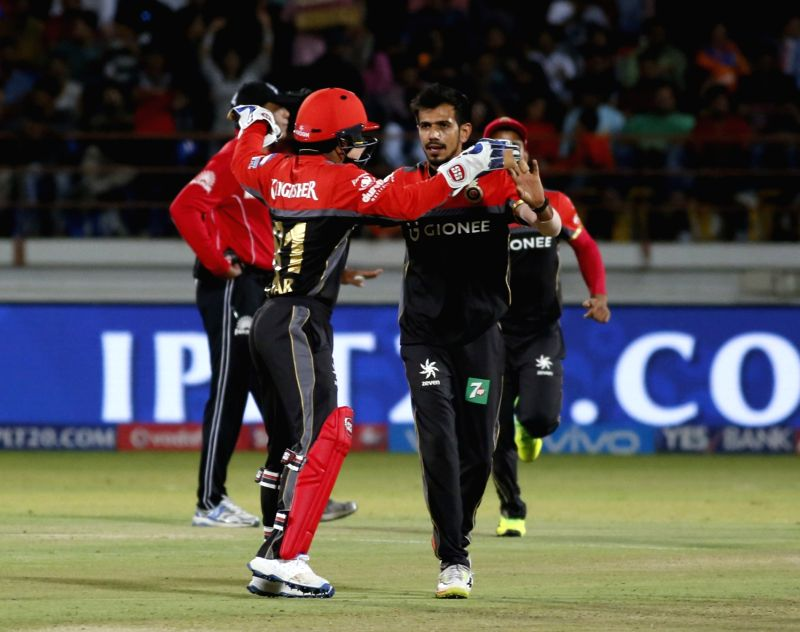 Yuzvendra Chahal of Royal Challengers Bangalore celebrate fall of a wicket during an IPL 2017 match between Royal Challengers Bangalore and Gujarat Lions at Saurashtra Cricket Association ...