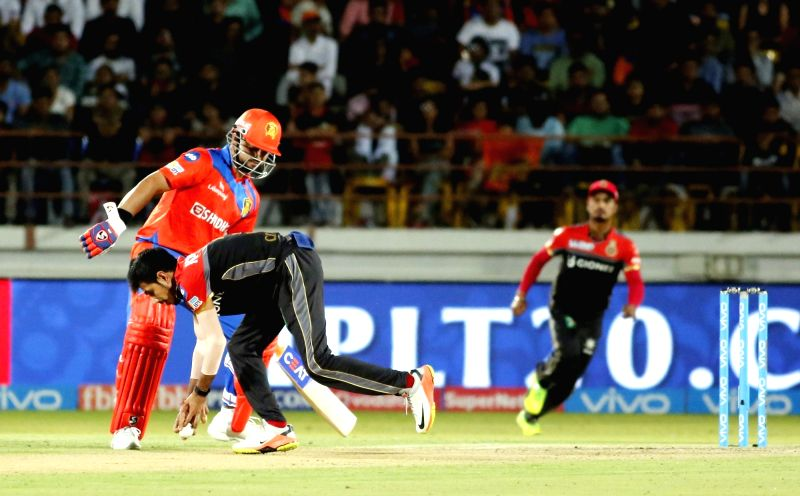 Yuzvendra Chahal of Royal Challengers Bangalore in action during an IPL 2017 match between Royal Challengers Bangalore and Gujarat Lions at Saurashtra Cricket Association Stadium in Rajkot on ...