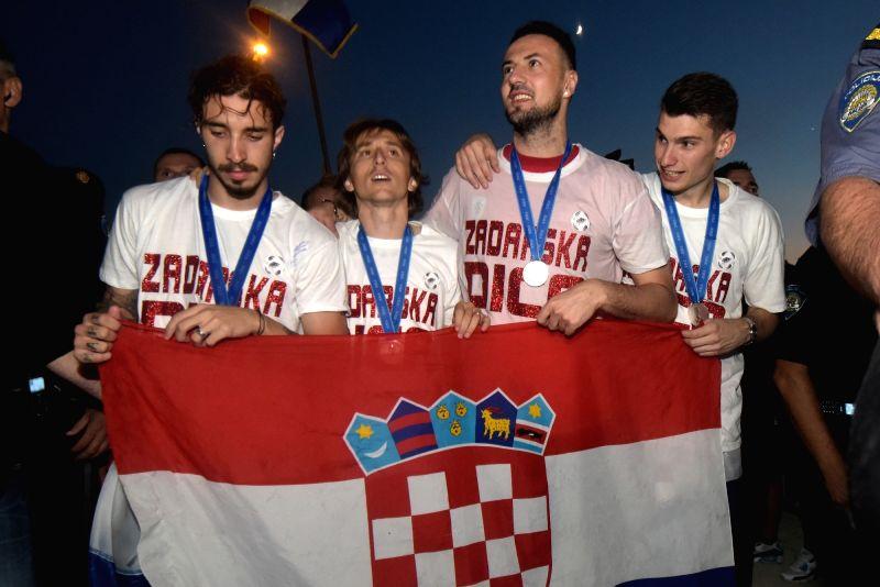 ZADAR, July 18, 2018 - Sime Vrsaljko (1st L), Luka Modric (2nd L), Danijel Subasic (2nd R) and Dominik Livakovic (1st R) of Croatian national football team celebrate on a boat in Zadar, Croatia, July ...