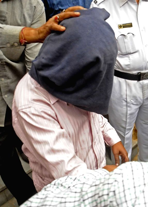 Zafar Khan who has been arrested by the Special Task Force (STF) of Kolkata Police for allegedly working for Pakistani spy agency Inter-Services Intelligence (ISI) being taken to be produced ... - Zafar Khan