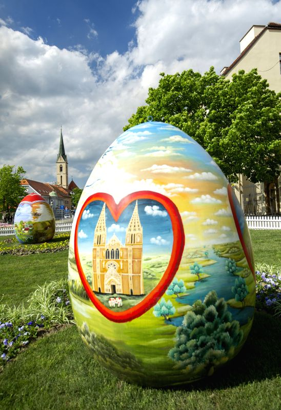 Photo taken on April 14, 2014 shows huge hand-painted Easter eggs on display near the Zagreb Cathedral on Kaptol in Zagreb, capital of Croatia, April 14, 2014. ...
