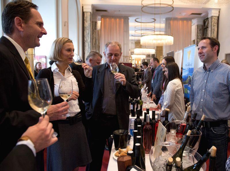 Zagreb (Croatia): Visitors taste wine during the 9th Zagreb VINOcom-International Festival of Wine and Culinary Art at the Esplanade hotel in Zagreb, capital of Croatia, Nov. 28, 2014. The two-day ...