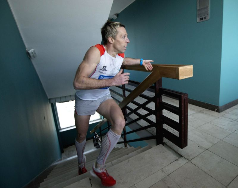 Matjaz Miklosa of Slovenia competes during the 3rd Zagrepcanka 512 Stairs Race in Zagreb, capital of Croatia, Dec. 13, 2014. Over 230 runners climbed 512 stairs (25 .