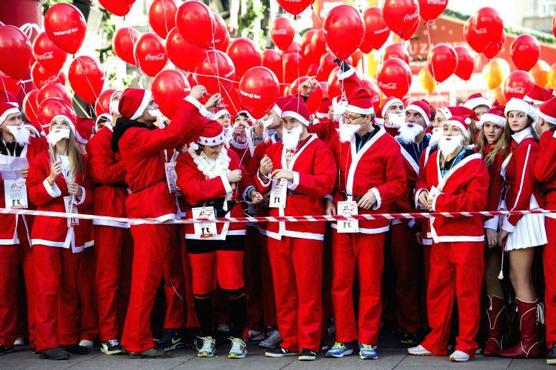 Participants dressed as Santa Claus take part in the 2014 Santa Race in Zagreb, capital of Croatia, Dec. 21, 2014. Hundreds of runners participated in the race on ...