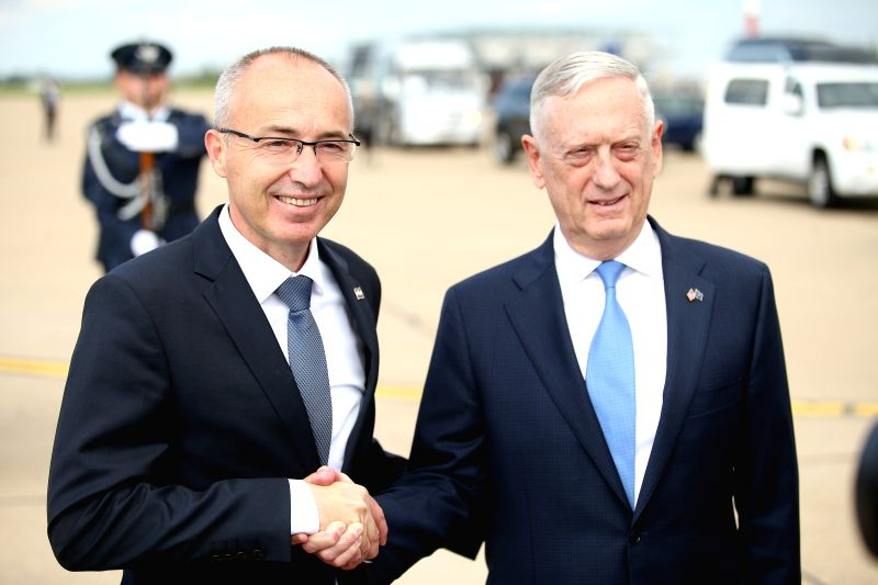 ZAGREB, July 12, 2018 - Croatian Defense Minister Damir Krsticevic (L) shakes hands with visiting U.S. Secretary of Defense James Mattis in Zagreb, Croatia, on July 12, 2018. James Mattis on Thursday ... - Damir Krsticevic
