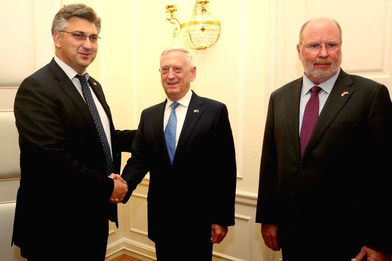 ZAGREB, July 12, 2018 - Croatian Prime Minister Andrej Plenkovic (L) shakes hands with visiting U.S. Secretary of Defense James Mattis (C) in Zagreb, Croatia, on July 12, 2018. James Mattis on ... - Andrej Plenkovic