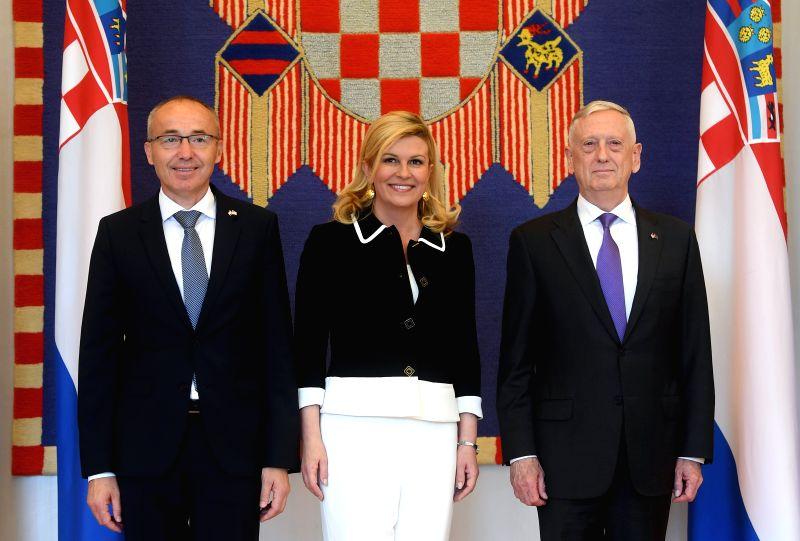 ZAGREB, July 13, 2018 - Croatian President Kolinda Grabar-Kitarovic (C) and defense minister Damir Krsticevic (L) receive US Secretary of Defense James N. Mattis in Zagreb, Croatia, on July 13, 2018. ... - Damir Krsticevic