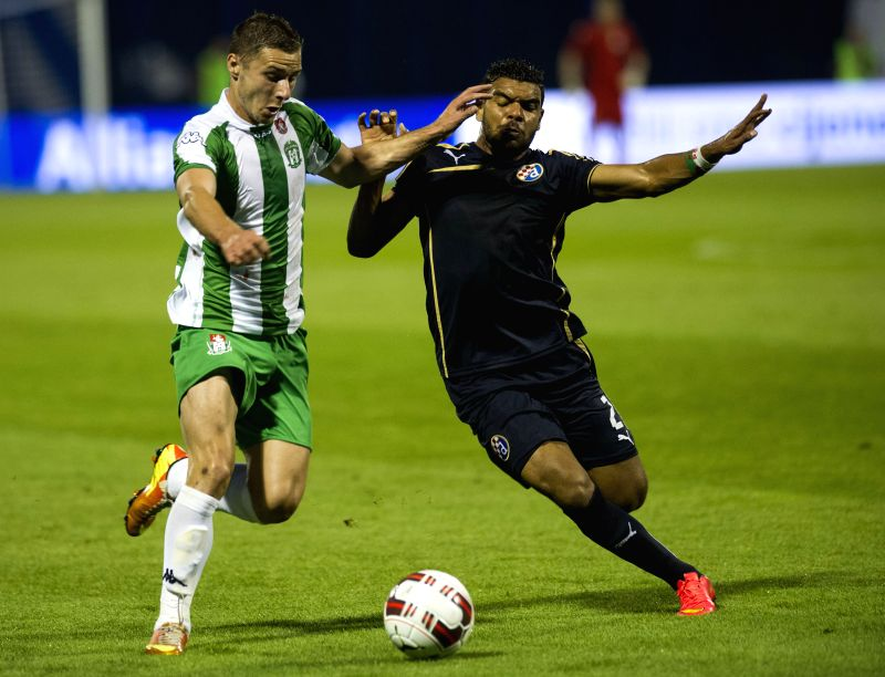 El Arabi Hilal Soudani of Dinamo Zagreb (R) fights for the ball with Andro Svrljuga of Zhalgiris Vilnius during UEFA Champions League 2nd Qualifying Round soccer ...