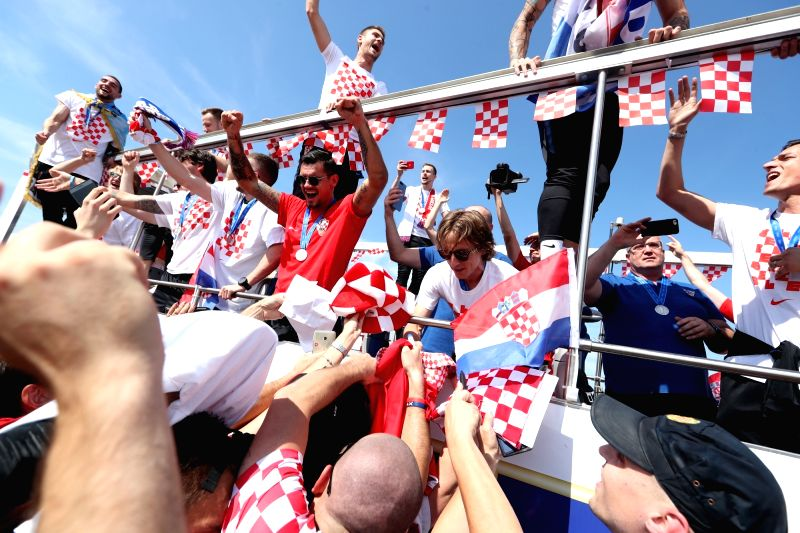 ZAGREB, July 16, 2018 - Members of Croatian national football team ride on a bus from the airport to the city center in Zagreb, capital of Croatia, on July 16, 2018. Croatia won the second place in ...