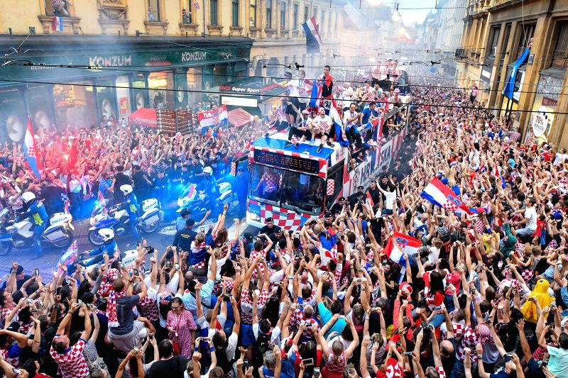 ZAGREB, July 17, 2018 - Members of Croatian national football team ride on a bus from the airport to the city center in Zagreb, capital of Croatia, on July 16, 2018. Croatia won the second place in ...
