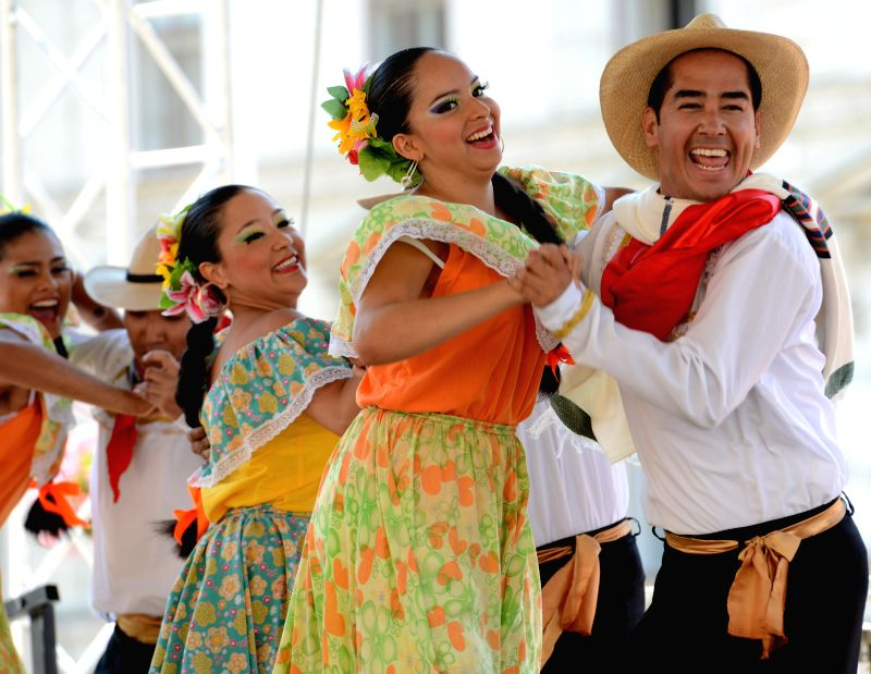 Participants from Columbia perform at the 48th International Folklore Festival in Zagreb, capital of Croatia, July 18, 2014. More than a thousand participants in 42 .