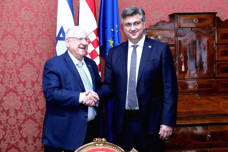 ZAGREB, July 24, 2018 - Croatian Prime Minister Andrej Plenkovic (R) shakes hands with visiting Israeli President Reuven Rivlin in Zagreb, capital of Croatia, on July 24, 2018. - Andrej Plenkovic