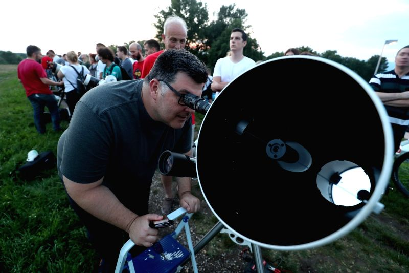 ZAGREB, July 27, 2018 - People watch the longest total lunar eclipse of the century at Jarun Lake in Zagreb, capital of Croatia, on July 27, 2018.