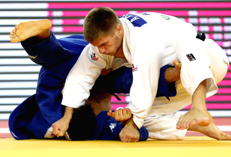 ZAGREB, July 29, 2018 - Akil Gjakova (R) of Kosovo and Fabio Basile of Italy compete during the men's -73kg category final at the 2018 IJF Judo World Tour Grand Prix in Zagreb, Croatia, on July 28, ...