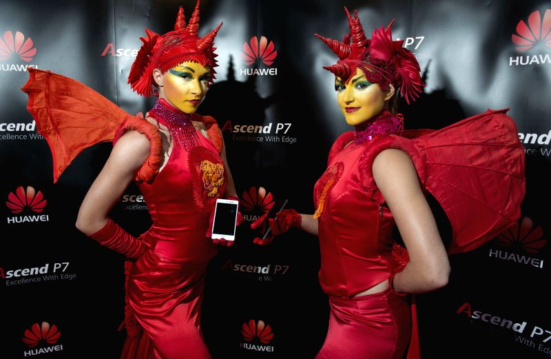 Models show Huawei Ascend P7 smartphones to guests during a presentation in Zagreb, Croatia, July 3, 2014. Huawei launched new flagship smartphone Ascend P7 in Zagreb