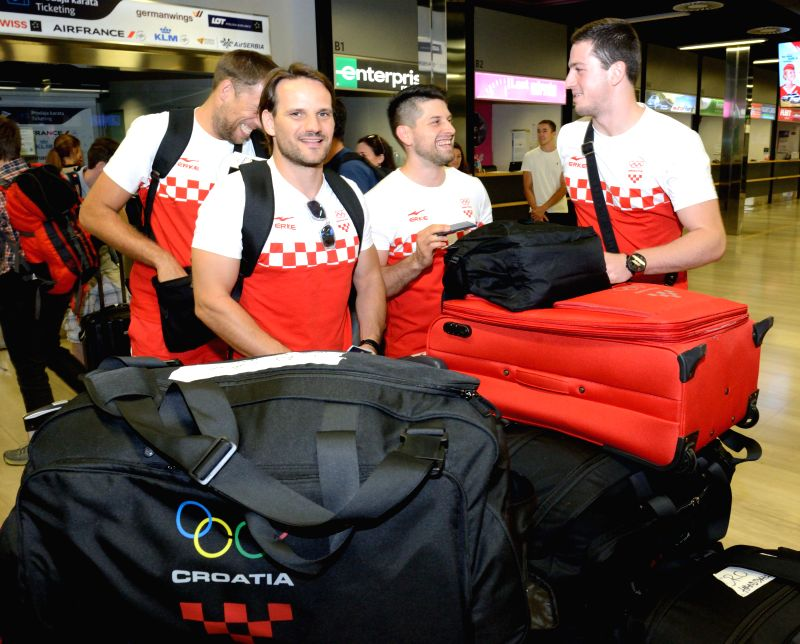ZAGREB, July 30, 2016 - Players of the Croatian handball national team prepare for a flight to Brazil at Pleso Airport in Zagreb, capital of Croatia, July 29, 2016. A total of 87 Croatian athletes ...