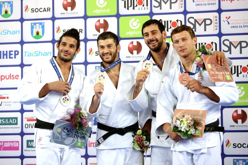 ZAGREB, July 30, 2018 - Gold medalist Avtandili Tchrikishvili (2nd L) of Georgia, silver medalist Asley Gonzalez (1st L) of Cuba, bronze medalists Mammadali Mehdiyev (2nd R) of Azerbaijan and Nemanja ...