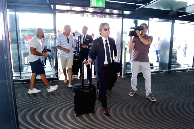 ZAGREB, June 12, 2018 - Croatian national football team's Luka Modric (Front) arrives at Franjo Tudman Airport before flying to Russia for the FIFA World Cup 2018, in Zagreb, Croatia, on June 11, ...