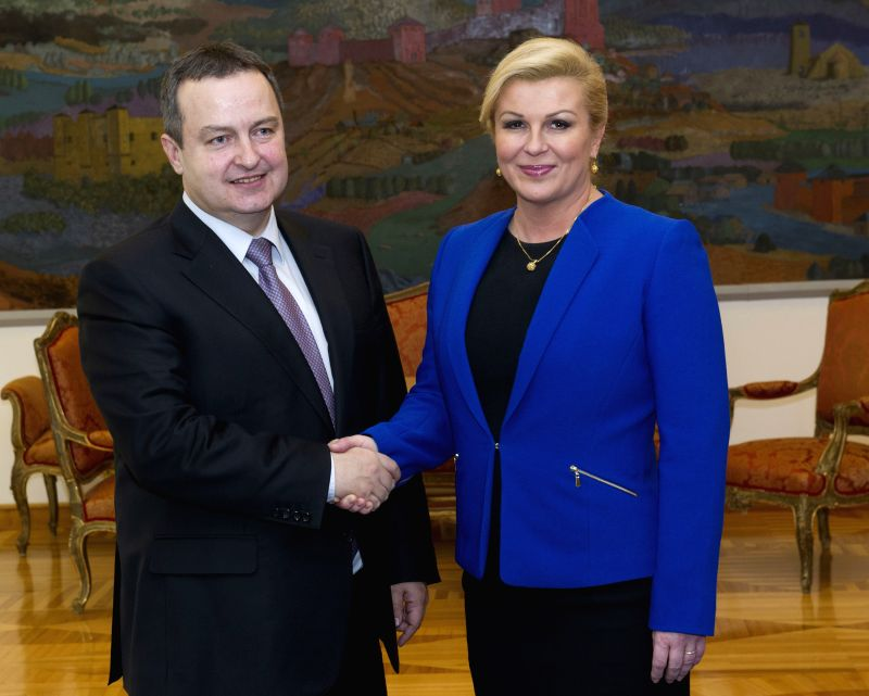 Visiting First Deputy Prime Minister and Minister of Foreign Affairs of the Republic of Serbia Ivica Dacic (L) shakes hands with Croatian President Kolinda ...