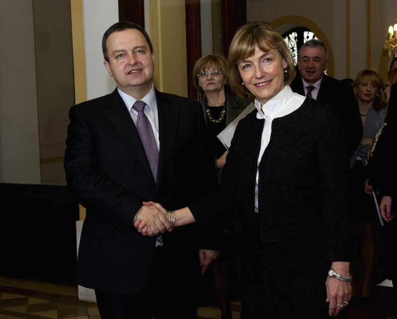 Visiting Serbian Foreign Minister Ivica Dacic (L) shakes hands with his Croatian counterpart Vesna Pusic before talks in Zagreb, capital of Croatia, March 11, 2015. ... - Ivica Dacic