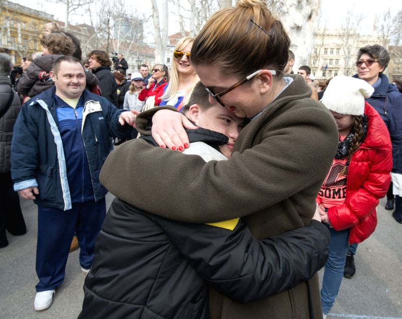 A woman hugs a teenager with Down syndrome (L) during the Down Syndrome Day concert in Zagreb, capital of Croatia, March 22, 2015.