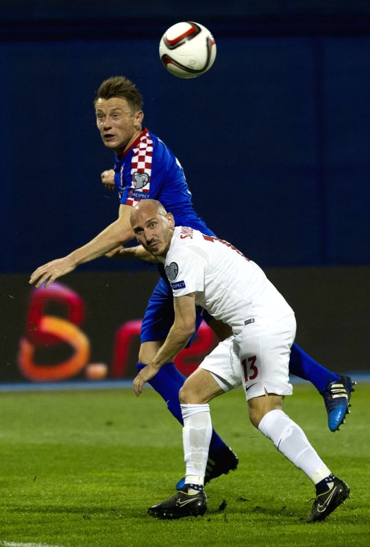 Ivica Olic (L) of Croatia vies with Jone Samuelsen of Norway during their UEFA Euro 2016 Group H qualifying match at Maksimir stadium in Zagreb, capital of Croatia, ...