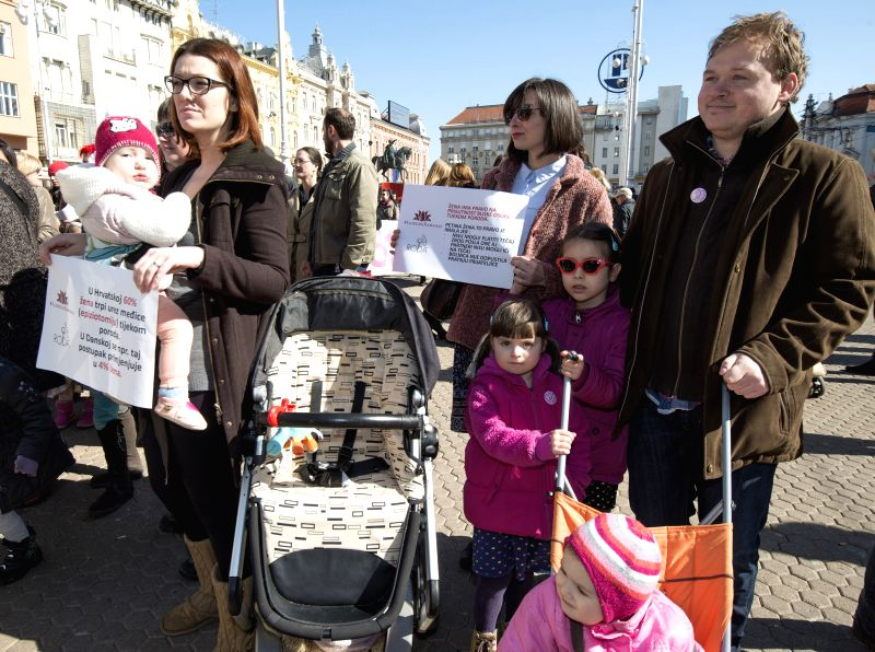 Croatian parental and children's rights activists protest in Zagreb, capital of Croatia, March 7, 2015. Members of RODA(Parents in action) Association staged a ...