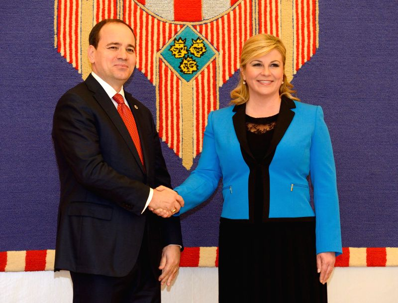 ZAGREB, May 10, 2016 - Visiting Albanian President Bujar Nishani (L) shakes hands with  Croatian President Kolinda Grabar-Kitarovic at the Presidential Palace in Zagreb, capital of Croatia, May 10,  ...