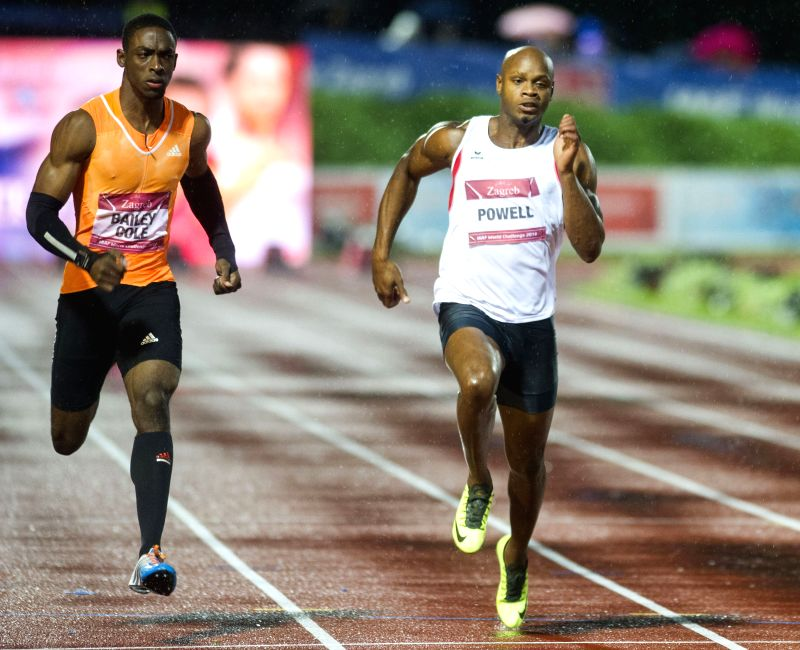 Kemar Bailey-Cole (L) and Asafa Powell of Jamaica compete during the men's 100m final at the IAAF World Challenge Zagreb 2014 in Zagreb, capital of Croatia, on Sept.