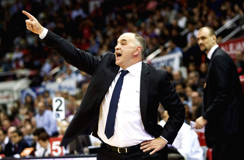 Zaragoza :  Real Madrid's coach, Pablo Laso, gives instructions to his players during the ACB league match against Cai Zaragoza held at the Principe Felipe Pavilion in Zaragoza, Spain, on 05 April ...