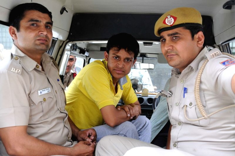 Zeeshan Rai, one of the accused in Ankit Gupta abduction and murder case, being taken away by Delhi Police on April 5, 2016. - Zeeshan Rai and Ankit Gupta