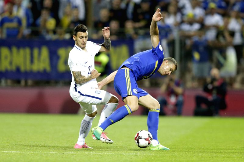 ZENICA, June 10, 2017 - Edin Dzeko (R) of Bosnia and Herzegovina (BiH) vies with Anastasios Donis of Greece during the 2018 FIFA Russia World Cup Qualifiers Group H match between Bosnia and ...