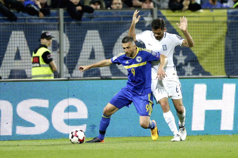 ZENICA, June 10, 2017 - Vedad Ibisevic (L) of Bosnia and Herzegovina (BiH) vies with Alexandros Tziolis of Greece during the 2018 FIFA Russia World Cup Qualifiers Group H match between Bosnia and ...
