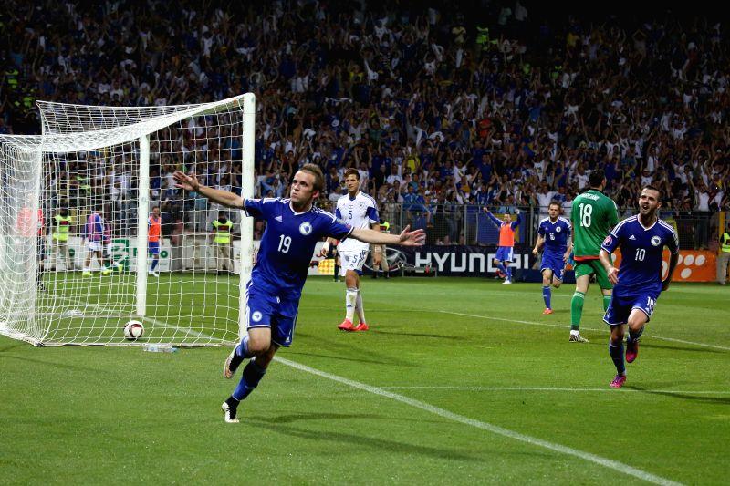 Edin Visca (L) of Bosnia and Herzegovina (BiH) celebrates for scoring during UEFA EURO 2016 qualifying match against Israel in Zenica, BiH, on June 12, 2015. BiH won ...