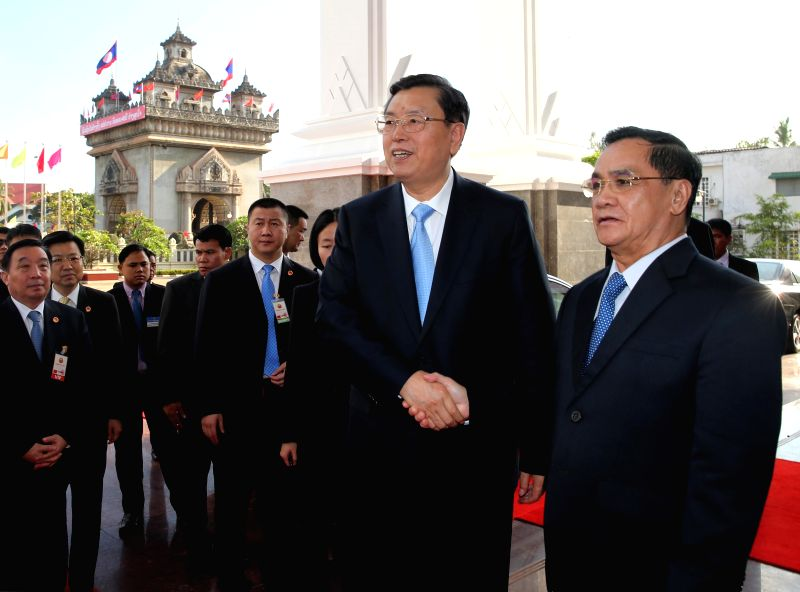 Zhang Dejiang (L front), visiting chairman of the Standing Committee of China's National People's Congress, meets with Lao Prime Minister Thongsing Thammavong in ... - Thongsing Thammavong