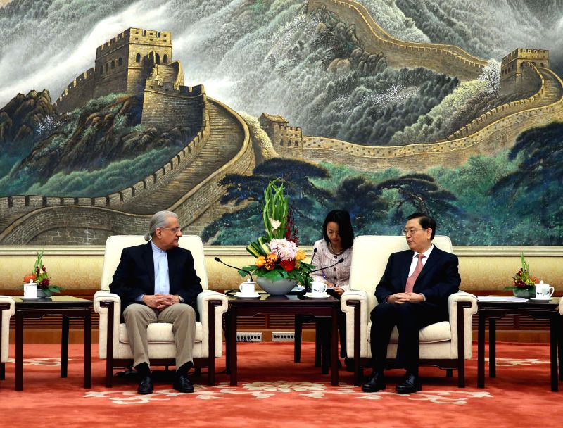 Zhang Dejiang (R), chairman of the National People's Congress Standing Committee, meets with Chairman of the Pakistani Senate Mian Raza Rabbani at the Great Hall of ...
